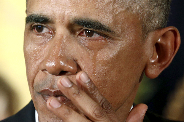 U.S. President Obama wipes a tear while talking about Newtown and other mass killings during an event held to announce new gun control measures at the White House in Washington